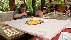 Nadine paints one painting